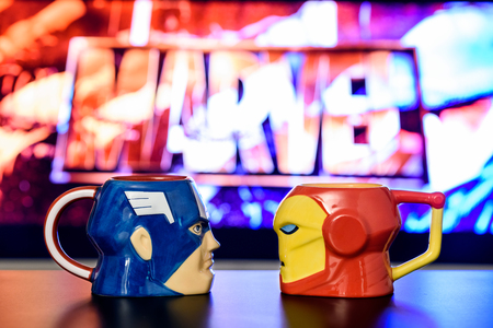 avenger: BUCHAREST, ROMANIA - SEPTEMBER 13,  2016: Movie Fans Drinking From Captain America And Iron Man Mugs At Marvel Avengers Movie Night. Editorial