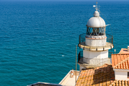 PENISCOLA, SPAIN - JULY 28, 2016: Lighthouse Of Peniscola Papa Luna Castle With Mediterranean Sea As Background.