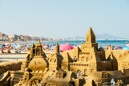 VALENCIA, SPAIN - JULY 28, 2016: Sand Castle Building On Peniscola Beach Resort At Mediterranean Sea.