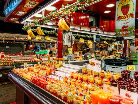 mercat: BARCELONA, SPAIN - AUGUST 05, 2016: Fresh Natural Fruit Juice For Sale In Barcelona Market (Mercat de Sant Josep de la Boqueria), a large public market with entrance from La Rambla street.