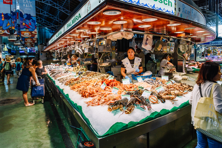 BARCELONA, SPAIN - AUGUST 05, 2016: Fresh Fish And Seafood For Sale In Barcelona Market (Mercat de Sant Josep de la Boqueria), a large public market with entrance from La Rambla street. Editorial