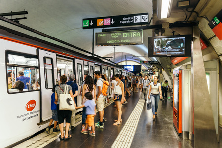 BARCELONA, SPAIN - AUGUST 05, 2016: People Travel By Subway Train In Downtown Barcelona City.