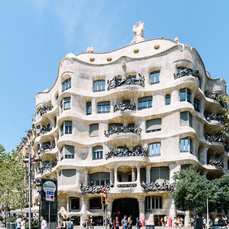 BARCELONA, SPAIN - AUGUST 05, 2016: Casa Mila or La Pedrera is a modernist building in Barcelona and was the last private residence designed by architect Antoni Gaudi built between 1906 and 1910.
