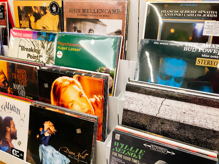 BUCHAREST, ROMANIA - MAY 06, 2017: Vinyl Record Cases Of Famous Music Bands For Sale In Music Store. Redakční