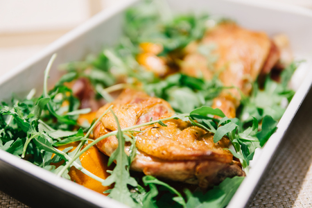 grill: Cooked Duck Legs In Oven With Rocket Salad And Citrus Sauce Stock Photo