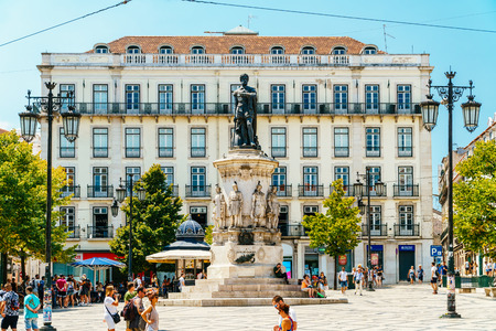 LISBON, PORTUGAL - AUGUST 12, 2017: Tourists exploring square of Luis de Camoes (Praca Luis de Camoes), one of the biggest squares in downtown Lisbon city in Portugal. Editorial