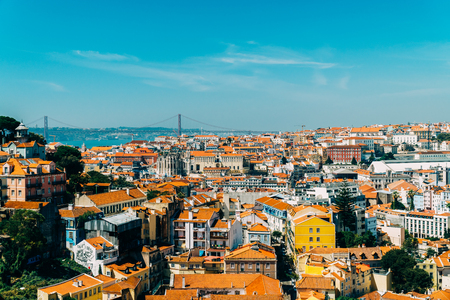 Aerial View Of Downtown Lisbon Skyline Of The Old Historical City And 25 de Abril Bridge (25th April Bridge) In Portugal Editorial