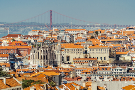 Aerial View Of Downtown Lisbon Skyline Of The Old Historical City And 25 de Abril Bridge (25th April Bridge) In Portugal Stock Photo