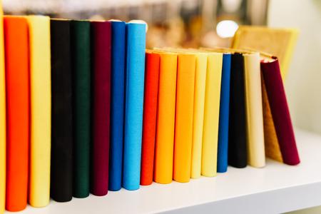 Colorful Agenda Books In A Row On Bookstore Shelf