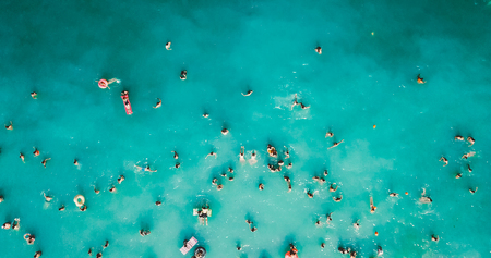 Aerial View From Flying Drone Of People Crowd Having Fun, Playing And Relaxing In Water At The Black Sea In Romania