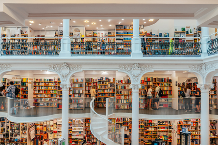 BUCHAREST, ROMANIA - JUNE 25, 2018: People Looking For A Wide Variety Of Books For Sale In Beautiful Library Book Store