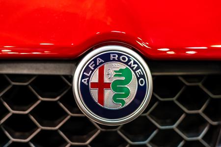 BUCHAREST, ROMANIA - OCTOBER 19, 2018: Alfa Romeo Logo Sign Closeup View On Car Front Grill