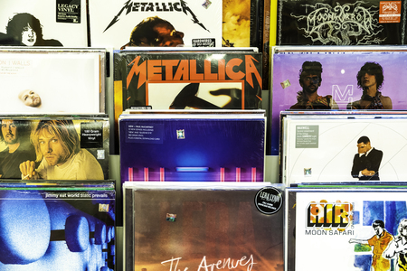 BUCHAREST, ROMANIA - JUNE 05, 2017: Vinyl Record Cases Of Famous Music Bands For Sale In Music Store Editorial