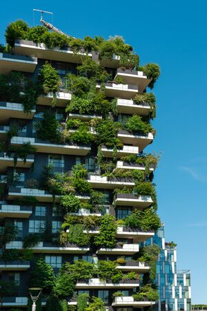 MILAN, ITALY - MAY 31, 2019: Bosco Verticale Or Vertical Forest Are A Pair Of Residential Towers In Milan. The Buildings Contain More Than 900 Trees, 5000 Shrubs and 11000 Floral Plants.