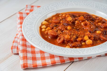 Chorizo Stew With Red Beans, Chickpeas And Tomato Sauce