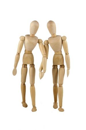 wooden mannequin: wooden dumies walk hand to hand