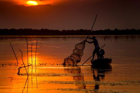 danube delta: Fisherman at sunset Stock Photo