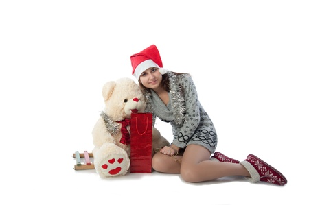 A girl in a red cap with a bear sitting and gift  photo