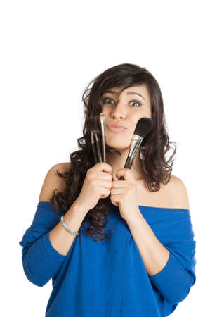 beautiful brunette holding a makeup brush photo