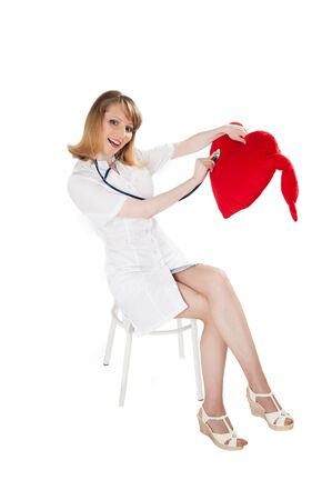 doctor listens phonendoscope toy heart photo