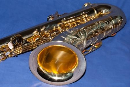 saxy: Saxophone on blue background Stock Photo