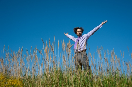 business man jumping on a background of blue sky photo