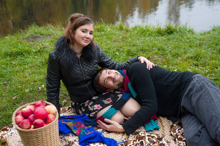 Beautiful loving couple in the Park in autumn picnic photo