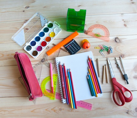 colored school: bunch of school supplies are on the table Stock Photo