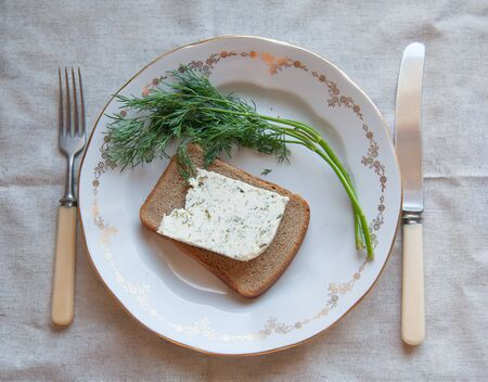the greens: kozeva piece of cheese on a plate with greens