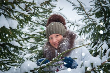 winter woman: woman at the winter tree