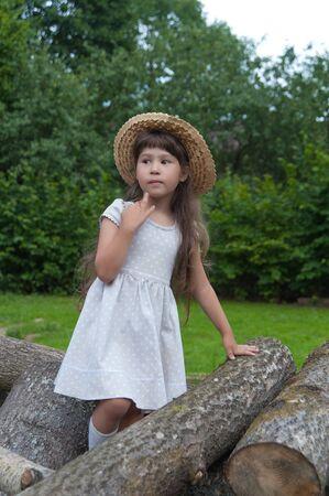 chapeau de paille: girl in a straw hat in the summer wood