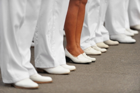 Navy officers stand in formation for Navy's Day Parade