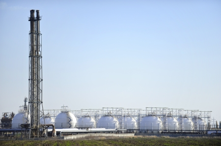 Gas storage tanks in petrochemical plant with clear sky on background photo