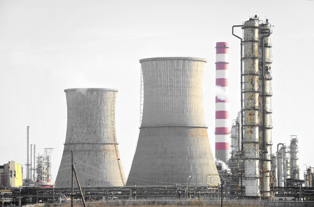 Industrial view with a petrochemical plant and cooling towers