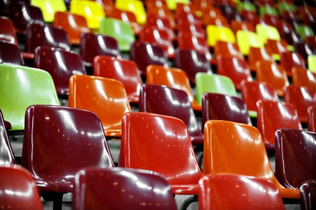 Empty stadium colored seats with nocturne lights reflections Stok Fotoğraf