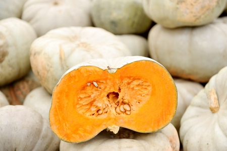Closeup with a sliced big pumpkin in a wholesale market photo