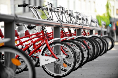Urban scene with bicycles for rent in a velo station