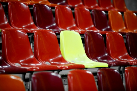 Red stadium colored seats and one yellow seat