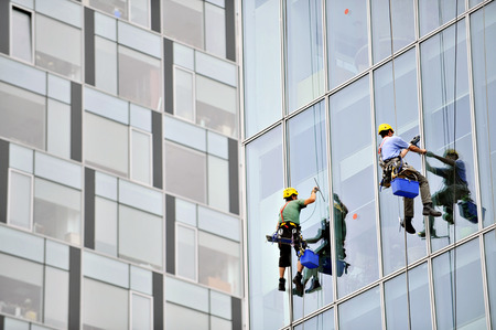 Window washers cleaning an office building exterior