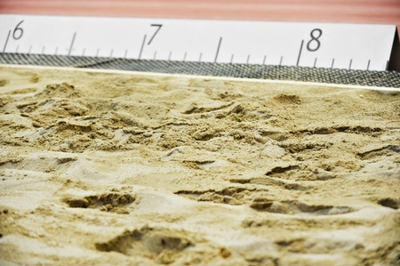 long jump: Athletics long jump sand pit with marks Stock Photo
