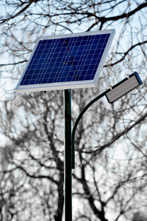 Park public lighting pole with photovoltaic panel photo