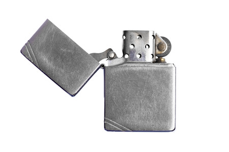 Used vintage metal lighter isolated on white background Stock Photo - 26037623