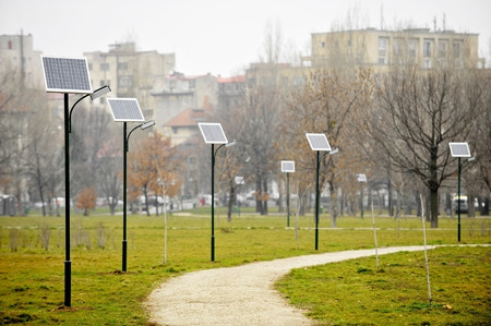 Park public lighting poles with photovoltaic panels photo