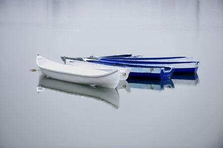 Empty abandoned fishing boats on a lake  photo