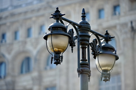 outdoor lighting: Outdoor public lighting pole with building on background