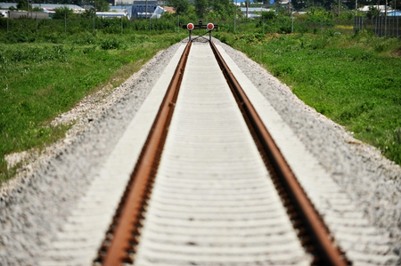iron barred: Empty industrial railway with buffer stop