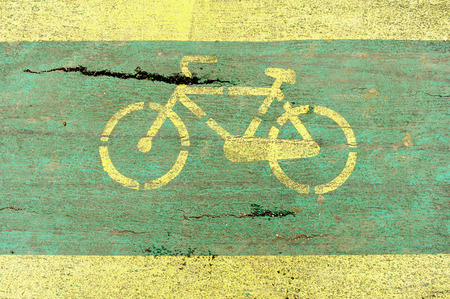 bicycle lane: Detail with a deteriorated bicycle lane Stock Photo