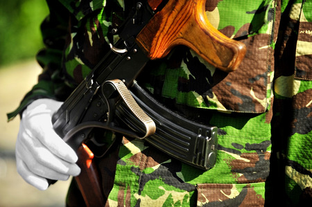 akm: Detail with a soldiers hand on a Kalashnikov AKM rifle during a military parade