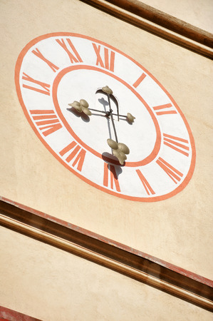 Architecture detail with old church clock tower and blue sky on background