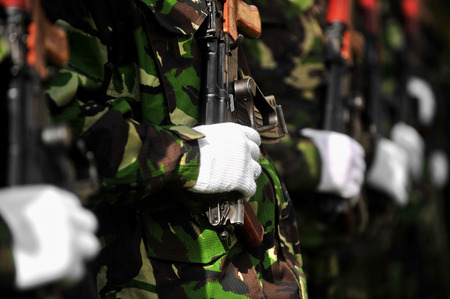 akm: Detail with a soldier hand on a Kalashnikov AKM rifle during a military parade